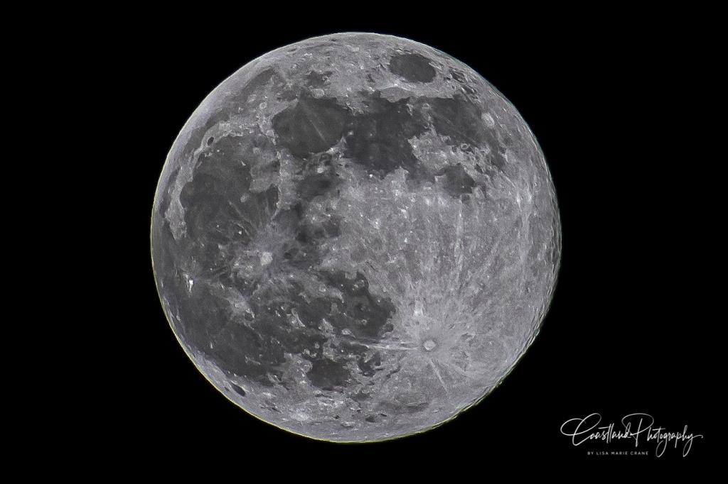 Pink full moon over Kill Devil Hills North Carolina.